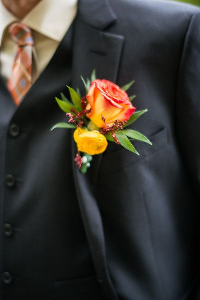 A red-orange rose makes a gorgeous boutonniere for a fall wedding. {J&R Photography}