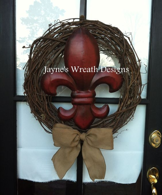 Grapevine wreath with large fleur de lis and burlap bow