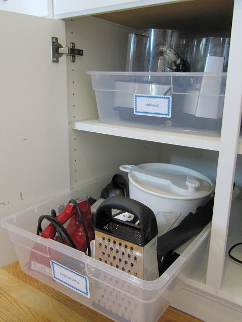 12 Easy Kitchen Organization Tips   Prentend kitchen cabinet pull-outs using large plastic storage tubs.