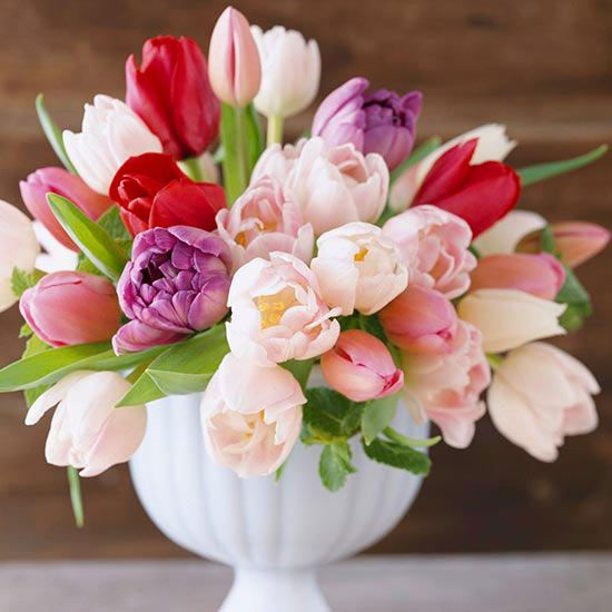 Avoid bending and drooping stems by cutting the tulips short, like these, so they can be arranged tightly enough to hold each other upright.