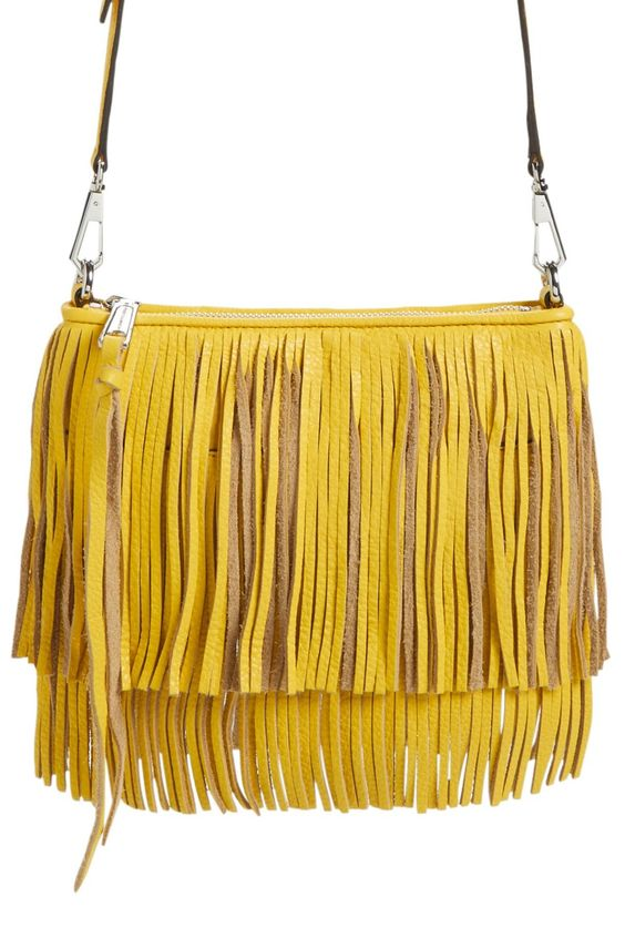 Tiered fringe amps up the street-chic attitude of a striking leather clutch furnished with an optional crossbody strap that offers effortless hands-free versatility.