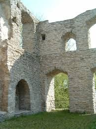 Stonework arches seen in a ruined stonework building – Burg Lippspringe, Germany.