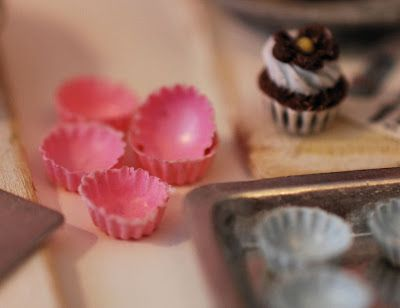 Cupcake liner tutorial by Christel Jensen - uses liquid Fimo tinted with chalk painted inside cupcake mold and baked, repeated applications - seems like a lot of work for ONE liner