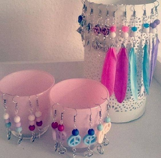 You can buy the beads and other materials for these peace and feather pastel earrings at www.BeadsandBasics.com