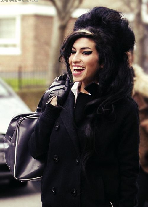 Amy Winehouse  Love this picture of her.  She looks happy: