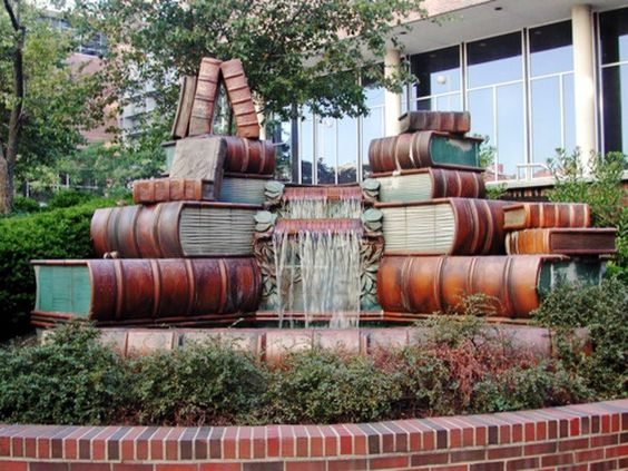 Stacked books waterfall?! AWESOME. The Amelia Valerio Weinberg Memorial Fountain (1990)@ Public Library of Cincinnati Ohio.