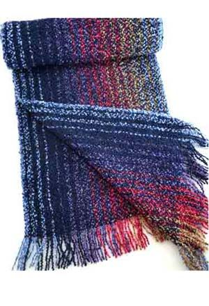 <p>When chill winds blow in from the Irish Sea, the men and  women of Killarney tuck handsome, locally woven scarves  around their necks, and go about their lives in warm  comfort. You share their pleasure when you wear this hand-  fringed beauty, with random  stripes that flow from navy blue, purple and red to tan  and light blue. It's made from 87% extra fine merino wool  and 5% cashmere for warmth and softness, plus 8% manmade  fiber for luxurious bouclé texture. Made in County Kerry…