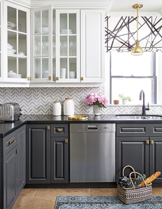 Here you get two of the best colors of cabinets for black granite side by side. Gray on the bottom and white on the top give you the perfect pairings for something a little more comfortable than elegant.