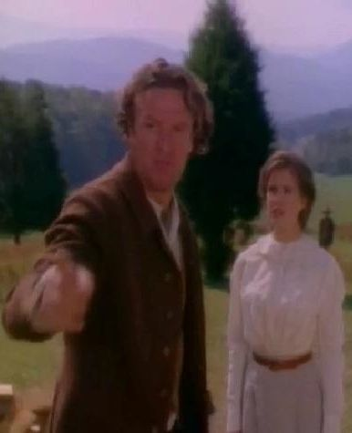 """Dr. MacNeill explains he hadn't come to follow up on her creek adventure, but was on the way back from Raven Gap when he'd heard about the moonshine incident. Pointing to David, the doctor calls the minister a """"damn fool""""."""