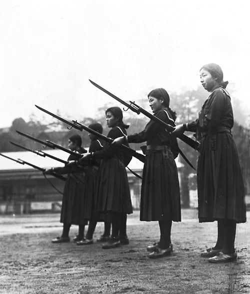 Young women learn how to charge an enemy with rifles and bayonets at their high school in Tokyo, Feb. 18, 1937.