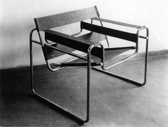 wasilly shair -Marcel Breuer - 1926 -   Bauhaus.    Inspired by the frame of a bicycle and influenced by the constructivist theories of the De Stjil movement, Breuer reduced the form of the classic club chair to its elemental lines and planes.: