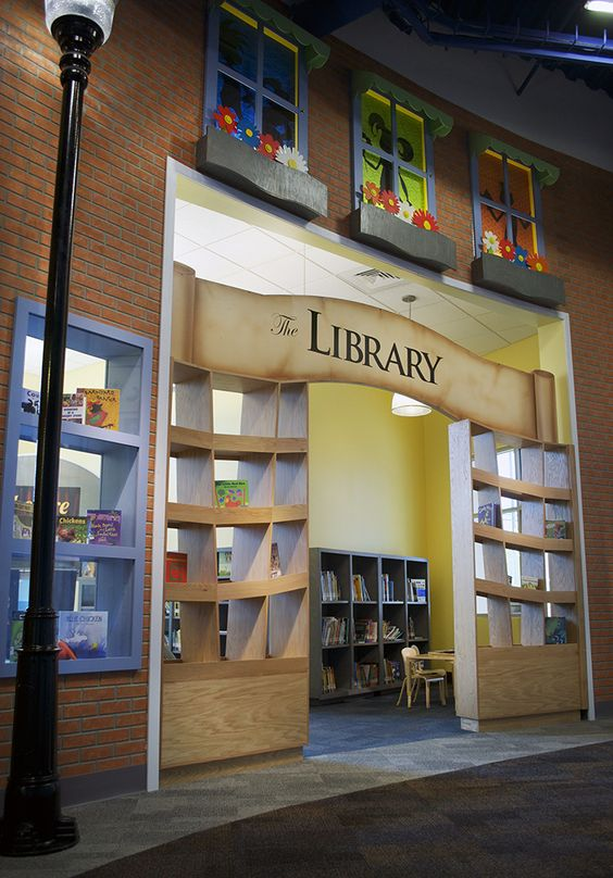 The Library at EdVenture Children's Museum ...  I love the sign.  Smaller for playroom reading nook.