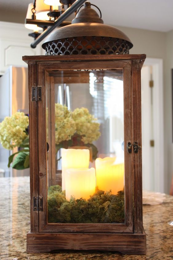 Moss and candles within a lantern ... I want to do this with my lanterns and the remote-controled LED candles I have.: