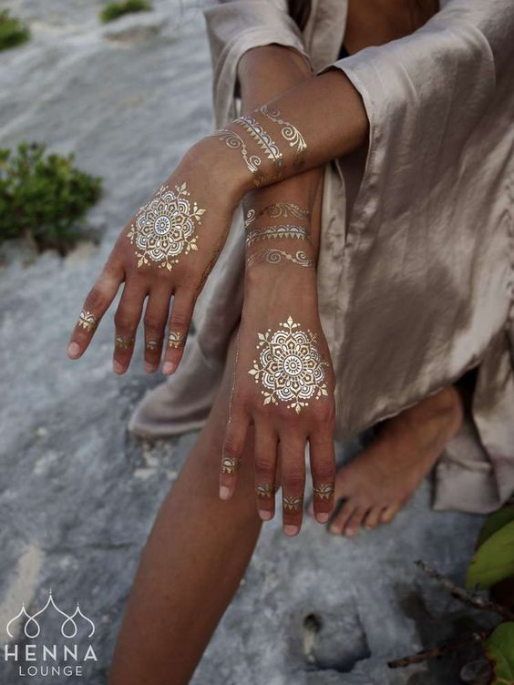 Gold tattoos are simply gorgeous.....