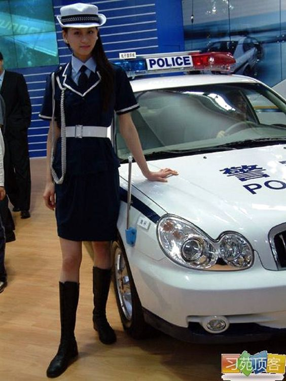 Police womam China.  http://www.carnewschina.com/2012/01/06/old-pic-a-police-woman-and-a-hyundai-sonata-police-car-in-china/