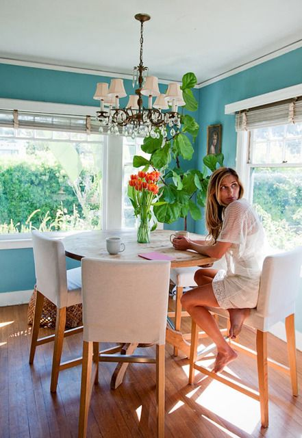 pretty dining room with bright walls and sunny windows. >> Love the tall table/stools too! Fun and casual.