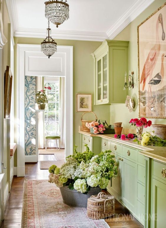 Vibrant spring green in a room for arranging flowers. Sarah Bartholomew Traditional Colorful Decor.