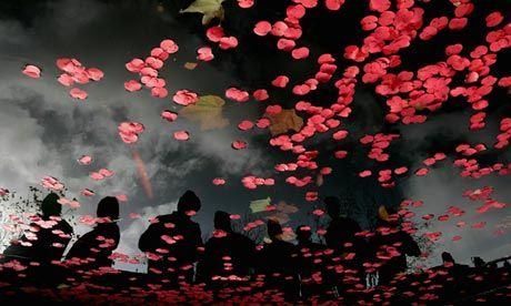 Poppies released in Swansea to commemorate armistice day. Campaigners want to challenge the narrative of the offical programme marking the centenary of the first world war. Photograph: Matt Cardy/Getty Images
