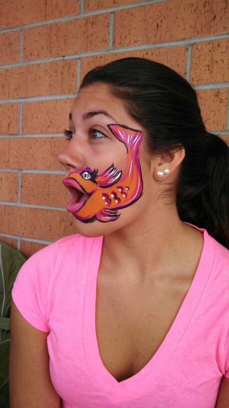 Fishy face paint. Really cute. Lol