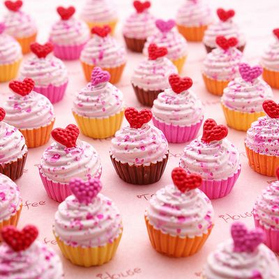 Pretty pink heart cupcakes for a whimsical mom's birthday party.
