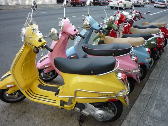 Would look for other Vespa's to park next too....and put to shame. #ridecolorfully