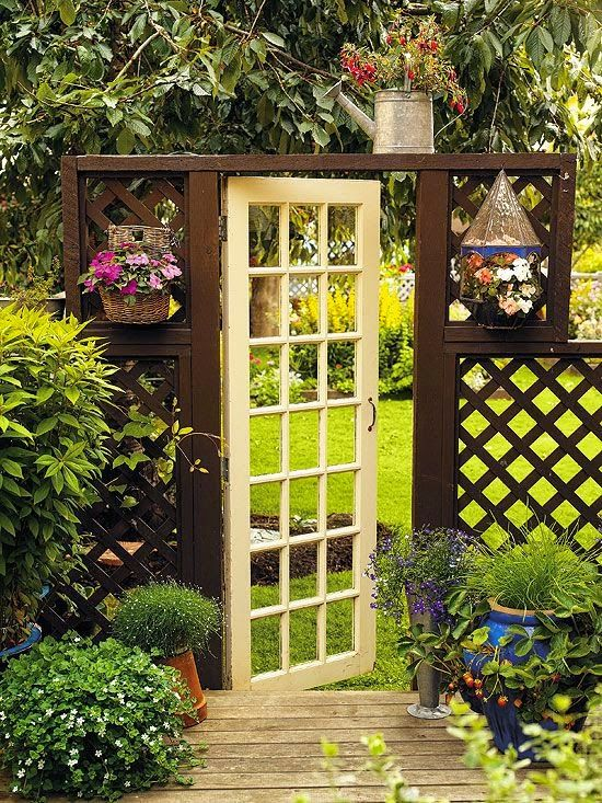 ♥ this find: $10 at a local flea market, this French door, with its glass panes still intact, separates a tenant's cozy container garden from the homeowner's yard. The open design of the door and lattice fence creates a sense of enclosure while still allowing views from adjoining spaces. >> This is super! So whimsical and beautiful!