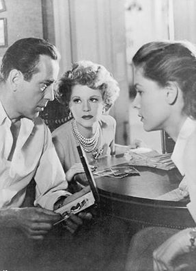 "Lauren Bacall with Humphrey Bogart and Claire Trevor in ""Key Largo"", 1948. This is one of my favorite films from that era, mostly because the sheer heated chemistry of Bogie and Bacall (who were married at the time). But who could forget the hilarious over-the-top evil of Edward G. Robinson's mob boss character? Miss Trevor went on to win a Best Supporting Oscar as Eddie G's boozy former moll. Well deserved. All-in-all, as a film, ""Key Largo"" was quite a thriller. L.M. Ross:"