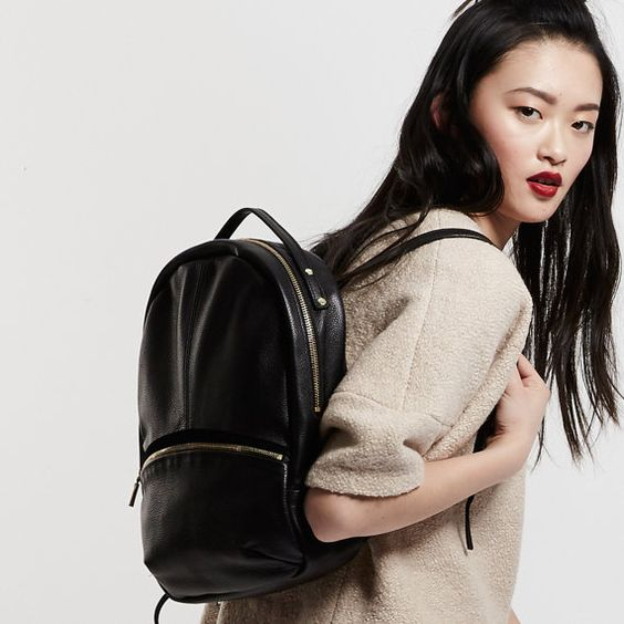 New for SS15, the Opelle Kanye Backpack is a modern staple. Designed with a rounded shape, curved zippers and contrast suede trim and sturdily