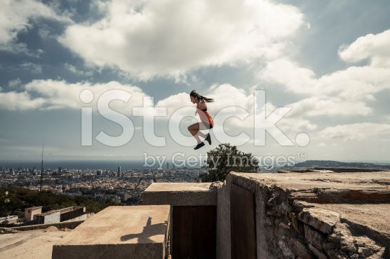 Girl jumping and practicing parkour in the city royalty-free stock photo