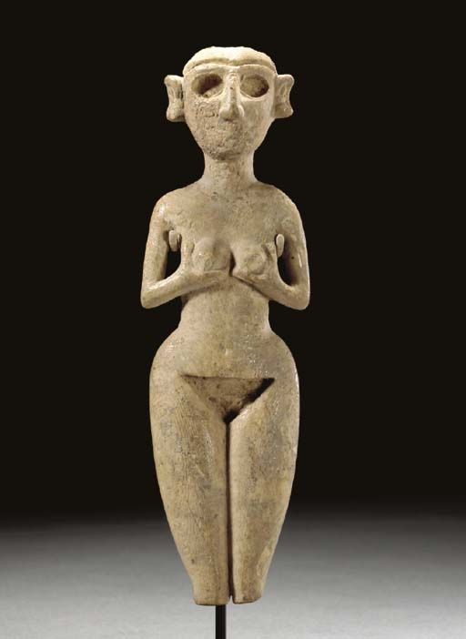 A MESOPOTAMIAN IVORY STANDING NUDE FEMALE FIGURE EARLY DYNASTIC IIIB, CIRCA 2400-2250 B.C.: