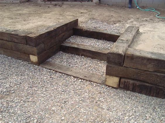 wall made with railroad tie | Retaining wall with railroad tie steps