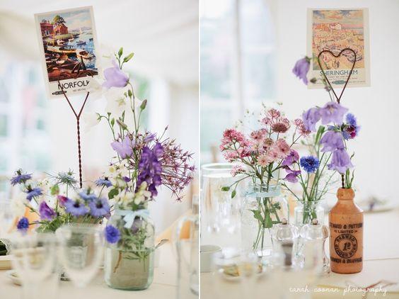 Marquee wedding - country garden flowers, bottles, jam jars, postcards, bunting, vintage
