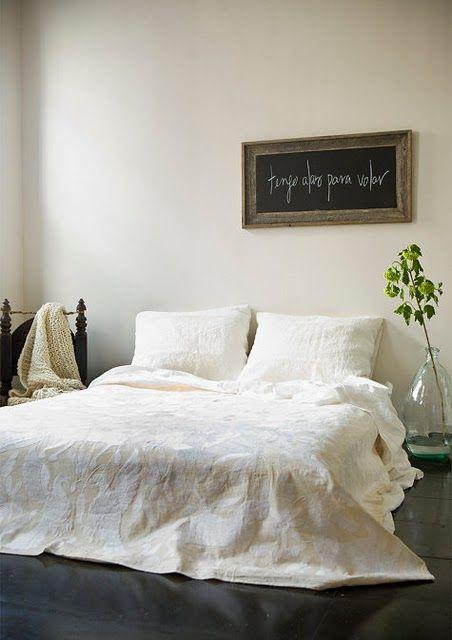 simple lovely bedroom / plant / white / blackboard