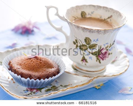 stock photo : Afternoon tea served with a gourmet cupcake