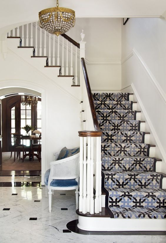 Color up the staircase! thin rail, dark wood, marble floor.