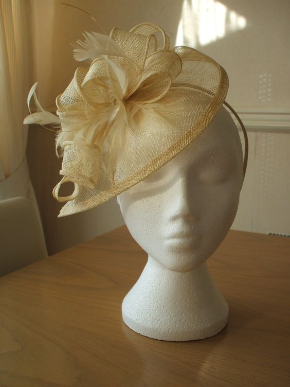 Champagne Gold Fascinator and Feather by joannelamacraft on Etsy, £30.00-for mom-chris' wedding