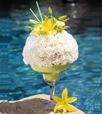 BLOOMING MARGARITA  Toast a special occasion the right way with our Floral Margarita! Comprised of white carnations, spray roses, solidago, and yellow lilies, this unique design is sure to be remembered!