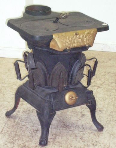 Rare Antique Laundry Stove. Heat water on top and notice the sad irons heating on the side.