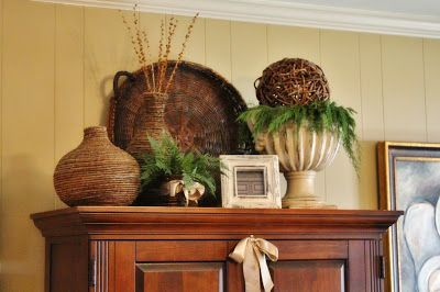 The Butlers: Holiday Home Tour  Like the ball on top of greenery in the urn