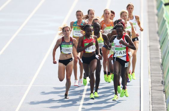 Hellen Onsando Obiri of Kenya and Yasemin Can of Turkey lead the pack during the Women's 5000m Round 1 - Heat 1 on Day 11 of the Rio 2016 Olympic Games at the Olympic Stadium on August 16, 2016 in Rio de Janeiro, Brazil.