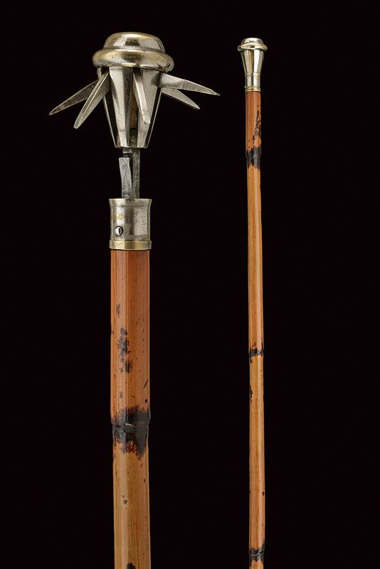 A Mace Disguised As A Walking Cane With Spring Loaded