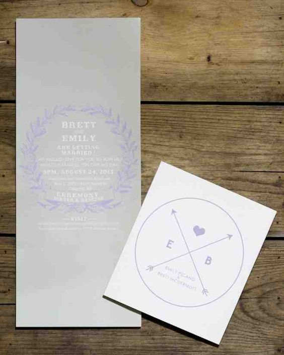 Stewart Innes designed Emily and Brett's wedding invitations. The outer sleeve featured crossed arrows set within a circle and accompanied by a heart and the first letters of each of their names.