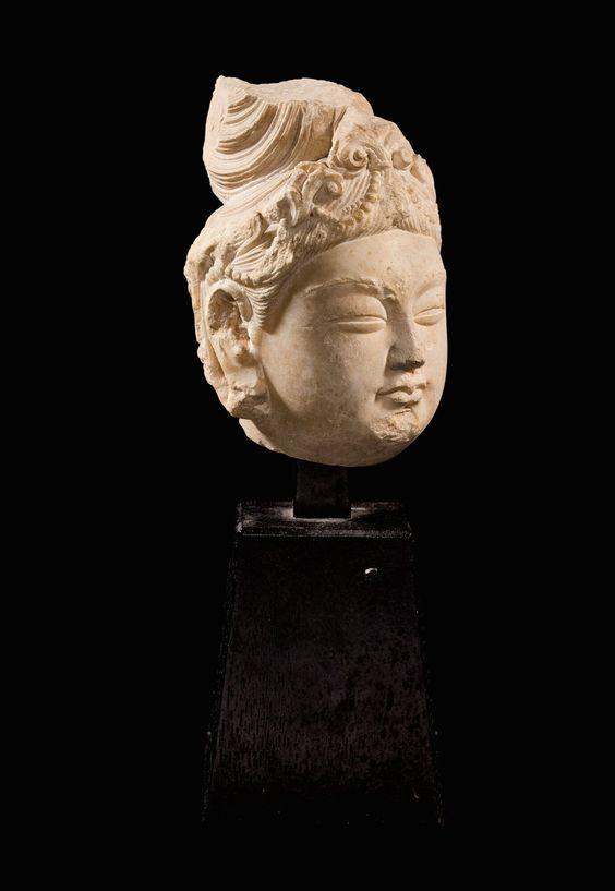A marble head ofAvalokiteshvara, Tang dynasty