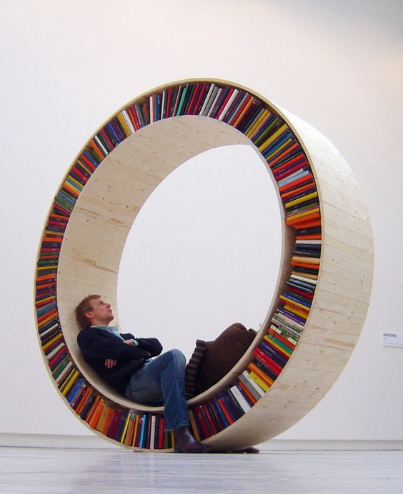"Love this book ""shelf""! I can imagine it up against a round window."