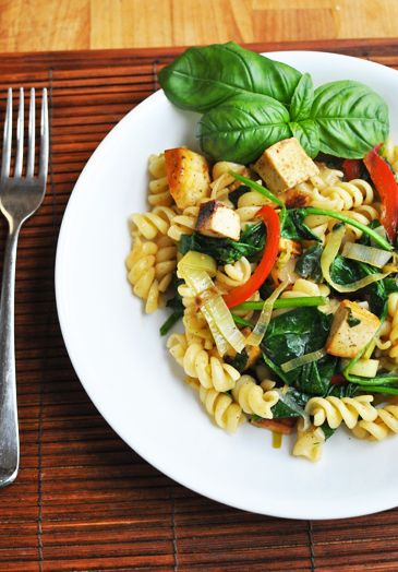 dinner - pasta, basil, tofu, peppers, onion, pine nuts.