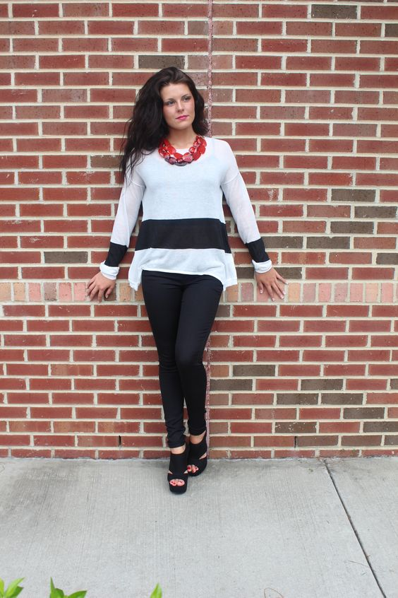 This light weight knit sweater pairs perfect with colored jeans!