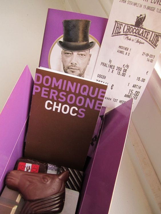 """Color photo of a box of chocolates """"The Chocolate Line"""" with a credit card slip showing 15 euros."""
