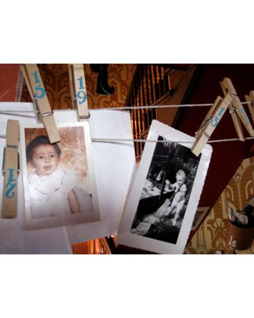 Guests looked at baby photos hung with numbered clothespins and guessed which photo belonged to which guest.