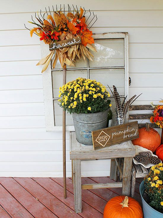 Pretty Front Entry Decorating Ideas For Fall Garden Rake Pheasant Feathers And Faux Flowers