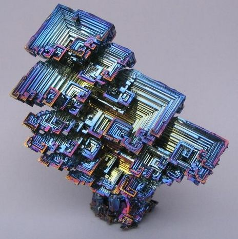 "This is a picture of a naturally-occurring Bismuth crystal. They are amazing and have awesome commercial and pharmaceutical benefits… but not for your skin. Many makeup companies use a derivative of this ore in their cosmetics because it has that beautiful iridescence to it. They advertise the benefits of ""natural"" ingredients in mineral makeup. Well arsenic is natural too, and Bismuth Oxychloride has a very similar chemical structure to arsenic! This ingredient is a by-prod..."